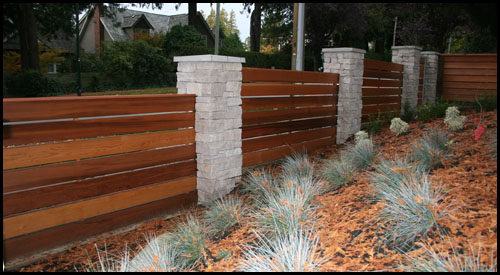 CEDAR FENCING INSTALLED INTO ROCK COLUMN (NO POSTS)