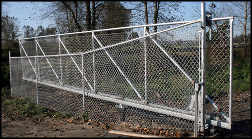 CHAIN LINK CANTILEVER DRIVEWAY GATE IN OPEN POSITION