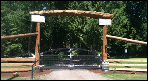 CUSTOM LOG ENTRANCE WITH CANTILEVER SLIDING DRIVEWAY GATE