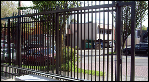 DRIVEWAY GATE IN OPEN POSITION WITH MATCHING FENCING