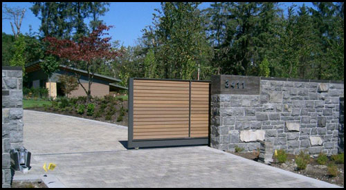 AUTOMATED SLIDING DRIVEWAY GATES IN MID POSITION