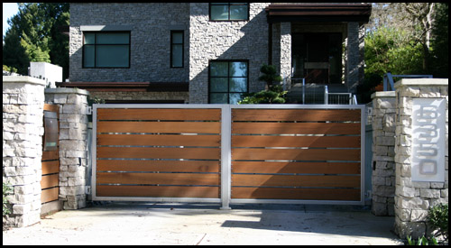 POWDER COATED STEEL FRAME IN-SWINGING DRIVEWAY GATE WITH CEDAR INSERTS